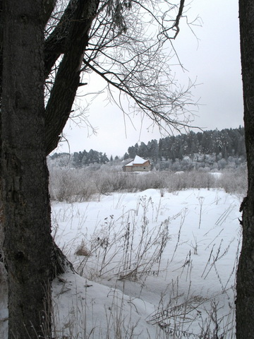 фото коттеджа на берегу озера, построенного по проекту Александра Легконогова